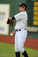 Elizabethton Twins starting pitcher Kohl Stewart #45 warms up before a game against the Greeneville Astros at Joe O'Brien Field on August 20, 2013 in Elizabethton, Tennessee. The Twins won the game 10-8. (Tony Farlow/Four Seam Images)