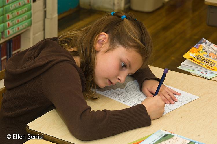 MR / Schenectady, NY. Elmer Avenue School (urban public elementary school). 3rd Grade. Student (girl: 8) writing a story in creative writing lesson. MR: Mit10. ID: AH-FRD. © Ellen Senisi