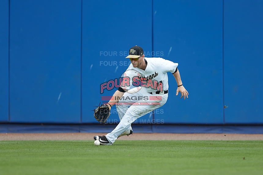 Wake Forest Demon Deacons left fielder Jonathan Pryor (11) fields the ball during the game against the Florida Gators in the completion of Game Two of the Gainesville Super Regional of the 2017 College World Series at Alfred McKethan Stadium at Perry Field on June 12, 2017 in Gainesville, Florida. The Demon Deacons walked off the Gators 8-6 in 11 innings. (Brian Westerholt/Four Seam Images)