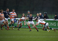 Robbie Fergusson of London Scottish Football Club hands off Luke Daniels of Ealing Trailfinders during the Greene King IPA Championship match between London Scottish Football Club and Ealing Trailfinders at Richmond Athletic Ground, Richmond, United Kingdom on 26 December 2015. Photo by Alan  Stanford / PRiME Media Images