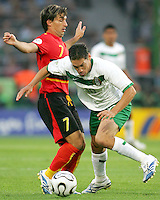 Guillermo Franco (10) of Mexico slips past Figueiredo (7) of Angola. Mexico and Angola played to a 0-0 tie in their FIFA World Cup Group D match at FIFA World Cup Stadium, Hanover, Germany, June 16, 2006.
