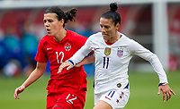 CARSON, CA - FEBRUARY 9: International Veterans Christine Sinclair #12 of Canada and Ali Krieger #11 of the USA battle during a game between Canada and USWNT at Dignity Health Sports Park on February 9, 2020 in Carson, California.