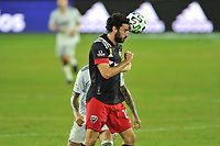 WASHINGTON, DC - SEPTEMBER 27: Steven Birnbaum #15 of D.C. United heads the ball during a game between New England Revolution and D.C. United at Audi Field on September 27, 2020 in Washington, DC.