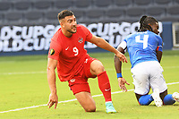 KANSAS CITY, KS - JULY 15: Lucas Cavallini #9 of Canada watches his shot go wide of the goal post during a game between Canada and Haiti at Children's Mercy Park on July 15, 2021 in Kansas City, Kansas.