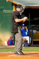 Home plate umpire Travis Godec inspects a baseball during the Appalachian League game between the Pulaski Mariners and the Bluefield Blue Jays at Bowen Field on July 1, 2012 in Bluefield, West Virginia.  The Mariners defeated the Blue Jays 4-3.  (Brian Westerholt/Four Seam Images)