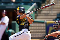 Dayne Parker (11) of the Wichita State Shockers follows through his swing during a game against the Missouri State Bears in the 2012 Missouri Valley Conference Championship Tournament at Hammons Field on May 23, 2012 in Springfield, Missouri. (David Welker/Four Seam Images)