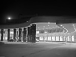 Pittsburgh PA: View of the main entrance of the Greater Pittsburgh airport at night. In 1944, Allegheny County officials proposed to expand the military airport with the addition of a commercial passenger terminal in order to relieve the Allegheny County Airport, which was built in 1926 and whose capacity was quickly becoming insufficient to support the growing demand for air travel.  The new airport, christened as Greater Pittsburgh Airport opened on May 31, 1952. The first flight occurred on June 3, 1952.