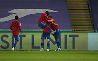 20th April 2021; Liberty Stadium, Swansea, Glamorgan, Wales; English Football League Championship Football, Swansea City versus Queens Park Rangers; Lyndon Dykes  celebrates with Charlie Austin  and Albert Adomah of Queens Park Rangers after scoring his sides first goal in the 89th minute to make score 0-1