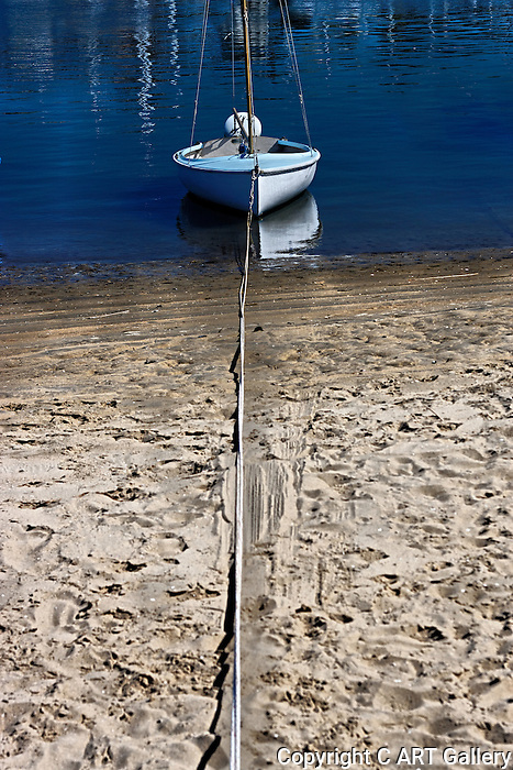 Dingy tied to shore, Balboa Island, CA.