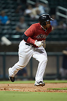 Xavier Fernández (34) of the Birmingham Barons hustles down the first base line against the Mississippi Braves at Regions Field on August 3, 2021, in Birmingham, Alabama. (Brian Westerholt/Four Seam Images)