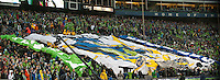 Fans unroll a huge banner as the Seattle Sounders defeated the Philadelphia Union, 2-0, in an MLS match on Thursday, March 25, 2010 at Qwest Field in Seattle, WA. It was the Sounders home opener and the first regular season game for the expansion Philadelphia Union.