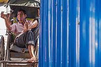 A rickshaw driver having a rest, Phnom Penh, Cambodia