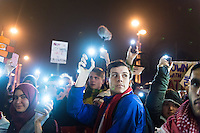 Protesters use the lights on their phones to show support for refugees on Queen Street in Wales' capital city, during a demo to protest Donald Trump's ban on people from certain Muslim-dominant countries from entering the US. Monday 30 January 2017