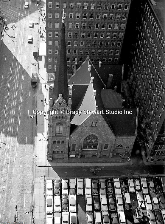 Pittsburgh PA: View of the First English Evangelical Church in downtown Pittsburgh.  Founded in 1837, the church was the first English-speaking Lutheran Church west of the Allegheny Mountains. This building on Grant Street was dedicated in 1888.  The Alcoa building is in the background.