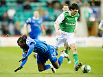 Hibs v St Johnstone....27.11.10  .Collin Samuel loses out to Ian Murray.Picture by Graeme Hart..Copyright Perthshire Picture Agency.Tel: 01738 623350  Mobile: 07990 594431