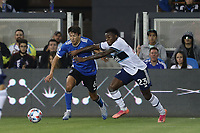 SAN JOSE, CA - AUGUST 13: Shea Salinas #6 of the San Jose Earthquakes is defended by Javain Brown #23 of the Vancouver Whitecaps during a game between Vancouver Whitecaps and San Jose Earthquakes at PayPal Park on August 13, 2021 in San Jose, California.