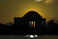 Jefferson Memorial backlit by the rising sun, Washington, DC