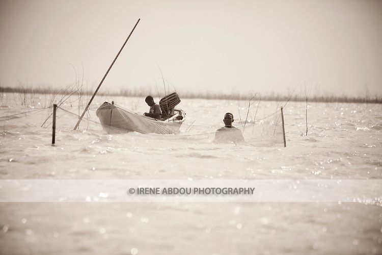 Fishermen ply the waters between Cotonou and Ganvie in Benin.