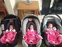 """Pictured: The three sisters when they went home from hospital<br /> Re: A set of identical triplets have been colour-coded to help teachers tell them apart on their first day in nursery school.<br /> Three-year-olds Ffion, Maddison and Paige Gilbert, are so alike even their parents struggle to know which is which.<br /> Karen and Ian Gilbert used different coloured nail-varnish on their fingers and toes to identify them when they were babies.<br /> Now the couple are using the same colours for their hair bands and bobbles at the nursery where they have just enrolled.<br /> And the colours even correspond with the names of the identical trio. <br /> Ffion has fuschia, Maddison has mint and Paige has purple.<br /> Karen, 35, of Pontypool, South Wales, said: """"We have colour-coded them since they were tiny babies - it helped us keep track of which ones had been fed.<br /> """"But nail varnish isn't allowed in school so we had come up with come other way."""