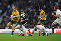 Rob Horne of Australia skips past Tom Wood of England during the QBE International match between England and Australia at Twickenham Stadium on Saturday 29th November 2014 (Photo by Rob Munro)