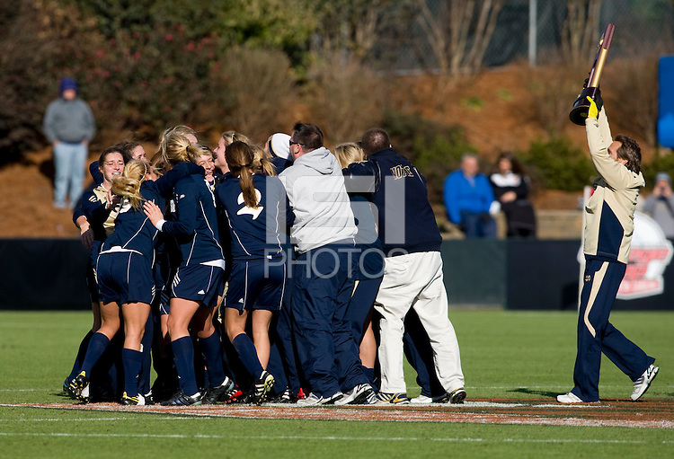 Head coach Randy Waldrum of Notre Dame brings the trophy to his team after the final of the NCAA Women's College Cup at WakeMed Soccer Park in Cary, NC.  Notre Dame defeated Stanford, 1-0.
