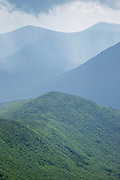 Storm clouds engulf the wilderness from the summit of Bondcliff in the Pemigewasset Wilderness of the New Hampshire White Mountains during the summer months.