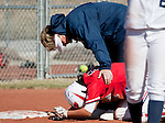 March 23, 2012:   Fresno State Bulldogs head coach Margie Wright looks at Andrea Ortega after a hard slide at third against the Nevada Wolf Pack during their NCAA softball game played at Christina M. Hixson Softball Park on Friday in Reno, Nevada.