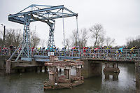 Peloton on the old industrial Zandbergen bridge over the Dender river<br /> <br /> 69th Kuurne-Brussel-Kuurne 2017 (1.HC)