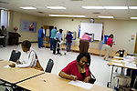 May 6, 2008. Durham, NC.. With the close North Carolina primary battle between Senators Hillary Clinton and Barack Obama, voters hit the polls to try and bring closure to this highly contested state and divide the delegates between the 2 candidates.. Renee Nixon, right, fills out her ballot. Turnout was high in several predominantly African American precincts in Durham.