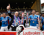 Mark Warburton celebrates Rangers league win with captain Lee Wallace