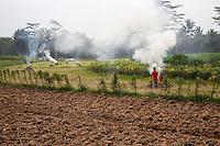 Borobudur, Java, Indonesia.  Preparing Fields to Plant Tobacco.  Burning Trash Contributes to Air Pollution.