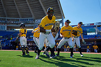 Michigan Wolverines players, including Christan Bullock (5), Miles Lewis (3), and Jimmy Kerr (15), take the field before a game against Army West Point on February 17, 2018 at Tradition Field in St. Lucie, Florida.  Army defeated Michigan 4-3.  (Mike Janes/Four Seam Images)