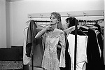 """Paul and Linda McCartney Wings Tour 1975. Linda in her Wardrobe room trying, checking out a dress for her performance that night, Bristol, England.. The photographs from this set were taken in 1975. I was on tour with them for a children's """"Fact Book"""". This book was called, The Facts about a Pop Group Featuring Wings. Introduced by Paul McCartney, published by G.Whizzard. They had recently recorded albums, Wildlife, Red Rose Speedway, Band on the Run and Venus and Mars. I believe it was the English leg of Wings Over the World tour. But as I recall they were promoting,  Band on the Run and Venus and Mars in particular."""