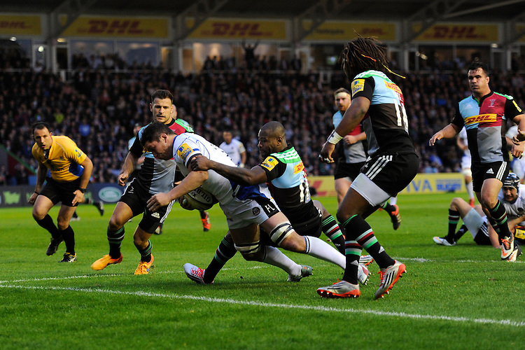 Francois Louw of Bath Rugby touches down for a try despite the efforts of Ugo Monye of Harlequins