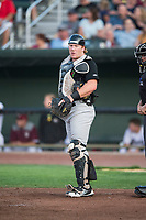 Great Falls Voyagers catcher Gunnar Troutwine (33) in front of home plate umpire Ethan McCranie during a Pioneer League game against the Idaho Falls Chukars at Melaleuca Field on August 18, 2018 in Idaho Falls, Idaho. The Idaho Falls Chukars defeated the Great Falls Voyagers by a score of 6-5. (Zachary Lucy/Four Seam Images)