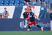FOXBOROUGH, MA - JUNE 26: Pierre Cacet #44 of the New England Revolution and Alex Bruce #28 of North Texas SC battle for the ball during a game between North Texas SC and New England Revolution II at Gillette Stadium on June 26, 2021 in Foxborough, Massachusetts.