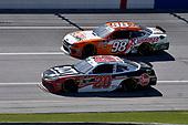 #20: Christopher Bell, Joe Gibbs Racing, Toyota Supra Rheem-Johns Mansville and #98: Chase Briscoe, Stewart-Haas Racing, Ford Mustang Nutri Chomps/Runnings