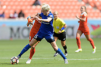 Houston, TX - Saturday May 27, 2017: Megan Rapinoe and Rachel Daly (3) of the Houston Dash battle for control of the ball during a regular season National Women's Soccer League (NWSL) match between the Houston Dash and the Seattle Reign FC at BBVA Compass Stadium.