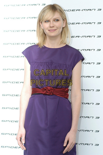 """KIRSTEN DUNST .Photocall for """"Spider-Man 3"""" held at the Hotel Excelsior, Rome, Italy..April 24th, 2007.half length purple sleeveless dress red belt.CAP/CAV.©Luca Cavallari/Capital Pictures"""