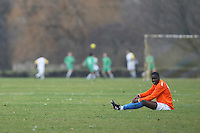 An Adam & Eve FC footballer takes a break during a Hackney & Leyton League match on at Hackney Marshes - 24/01/10 - MANDATORY CREDIT: Gavin Ellis/TGSPHOTO - Self billing applies where appropriate - Tel: 0845 094 6026