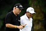 TAIPEI, TAIWAN - NOVEMBER 19:  Roger Chapman (L) of England and Lu Chien Soon of Taiwan talk on the 2nd hole during day two of the Fubon Senior Open at Miramar Golf & Country Club on November 19, 2011 in Taipei, Taiwan.  Photo by Victor Fraile / The Power of Sport Images
