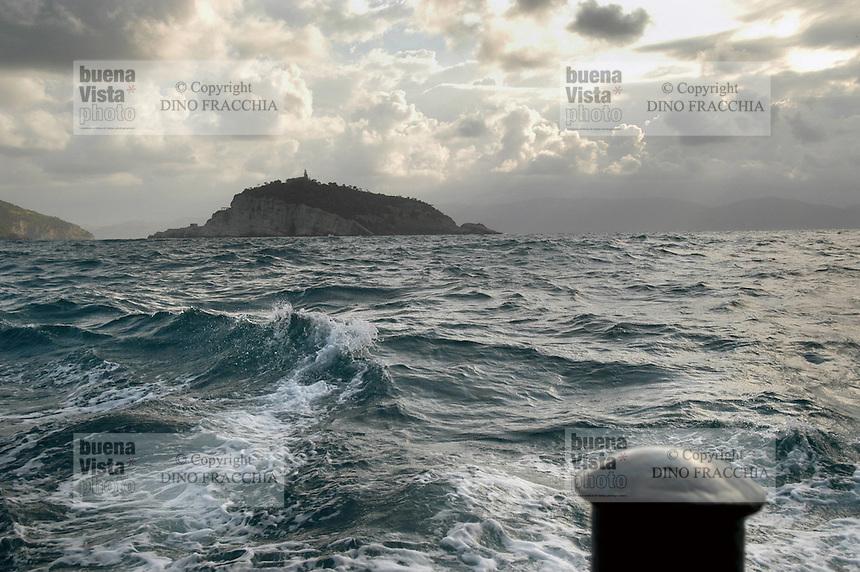 - Portovenere (La Spezia), island of the Tino seen from a boat with stormy sea ....- Portovenere (La Spezia), isola del Tino vista da bordo di un battello con mare agitato....