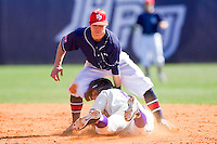 Devin Bujnovsky #6 of the High Point Panthers is tagged out at second base by Brian Blasik #18  of the Dayton Flyers at Willard Stadium on February 26, 2012 in High Point, North Carolina.    (Brian Westerholt / Four Seam Images)