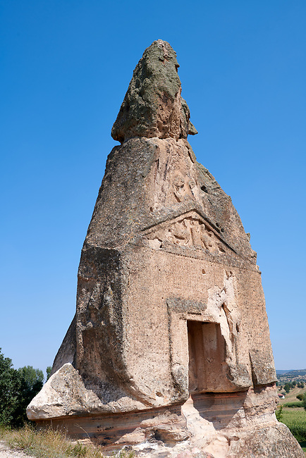 Phrygian temple of Aslankaya, 7th century BC. Phyrigian Valley, Emre Lake, near Döğer, Turkey.<br /> <br /> On the triangular roof over the facade are two sphinxes (winged figures with the head of a human and the body of a lion), facing one another, take place. In the main facade, below, the sphinxes in a niche, a cult statue of Kybele or the Great Mother (vandalised and destroyed) was flanked by two lions. This main facade is ornamented with relief geometrical patterns.