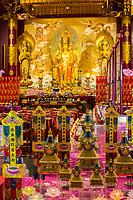 Singapore Buddha Tooth Relic Temple.  Buddha Maitreya Flanked by Two Bodhisattvas in Main Prayer Hall.