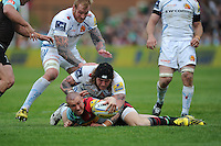 Mike Brown of Harlequins sets the ball up as Harry Williams and David Ewers of Exeter Chiefs attempt to turn it over during the Aviva Premiership match between Harlequins and Exeter Chiefs at The Twickenham Stoop on Saturday 7th May 2016 (Photo: Rob Munro/Stewart Communications)