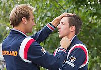 12-09-12, Netherlands, Amsterdam, Tennis, Daviscup Netherlands-Swiss, Press-conference Netherlands, Thiemo de Bakker(L) is grooming the hear of Igor Sijsling