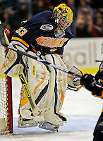 16 November 2008: Merrimack College Warriors' goaltender Andrew Braithwaite, a Junior from Kingston, Ontario, makes a second period save against the University of Vermont Catamounts at Gutterson Fieldhouse, in Burlington, Vermont. The Catamounts defeated the Warriors 2-1 in front of a near-capacity crowd of 3,813...Mandatory Photo Credit: Ed Wolfstein Photo