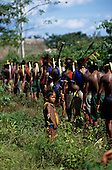 Bacaja village, Amazon, Brazil. A child watches the young men going to the hornets' nest initiation ceremony; Xicrin tribe.