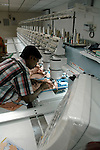 An Indian man working with a Brudan 920 (9colour 20 heads) at Prime Tex embroidery making factory in Tirupur, Tamilnadu. After lifting of quota system in textile export on 1st january 2005. Tirupur has become the biggest foreign currency earning town of India.